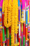 Colorful plastic garlands for worship Stock Images