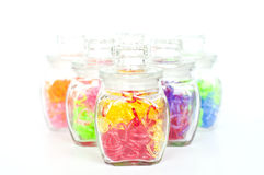 Colorful plastic hearts in glass bottles. Stock Photo