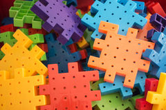 Colorful plastic jigsaw puzzle game Stock Photography
