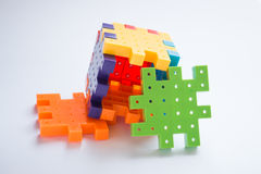 Colorful plastic jigsaw puzzle game Royalty Free Stock Images