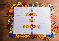 Colorful plastic letters, back to school, notebook with formulas Royalty Free Stock Image