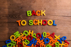 Colorful plastic letters, numbers, back to school,  wooden backg Royalty Free Stock Photography