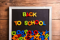 Colorful plastic letters in picture frame, back to school, Stock Images