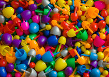 Colorful plastic mosaic pins. Background with multicolored random sized plastic mosaic pins Royalty Free Stock Images