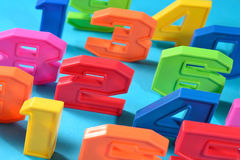 Colorful plastic numbers on a blue background Royalty Free Stock Image