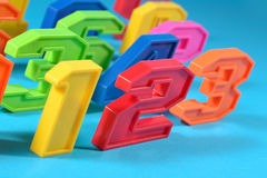 Colorful plastic numbers 123 on a blue background Stock Photos