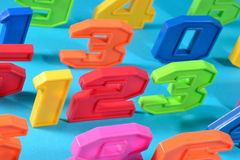 Colorful plastic numbers 123 on a blue background Royalty Free Stock Image