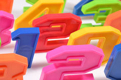 Colorful plastic numbers close up on a white Stock Photos