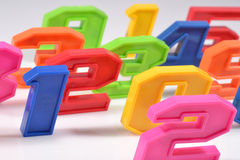 Colorful plastic numbers close up on a white Stock Photo