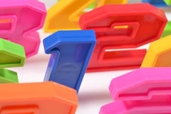 Colorful plastic numbers close up on a white Royalty Free Stock Photos