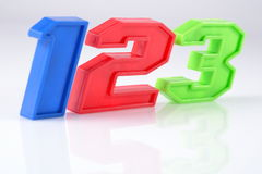Colorful plastic numbers 123 on white Royalty Free Stock Photography