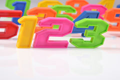 Colorful plastic numbers 123 on white Stock Images