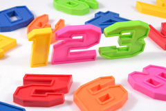 Colorful plastic numbers 123 on white Stock Photography
