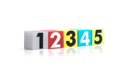 Colorful plastic numbers on  white background Royalty Free Stock Images