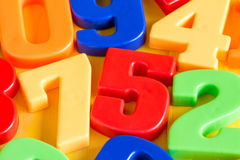 Colorful plastic numbers on a wooden table Royalty Free Stock Photo