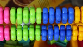 Colorful plastic rings for count on playground. Close up Royalty Free Stock Image