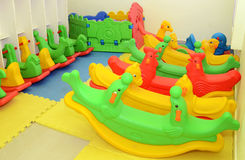 A colorful plastic seesaw Royalty Free Stock Images
