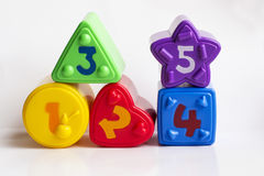 Colorful plastic shapes with numbers on a white background Stock Photo