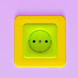 Colorful plastic socket. Colorful yellow, green and violet plastic socket on the wall royalty free illustration