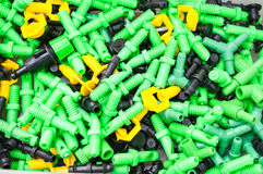 Colorful plastic sprinkler heads Stock Photography
