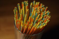 Colorful Plastic Straw on a Glass Container Stock Photography