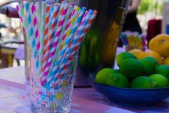 Colorful plastic straws on the table stock photography