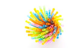 Colorful plastic straws used for drinking water or juices. Colorful plastic straws used for drinking water or juices on white background Royalty Free Stock Images