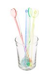 Colorful plastic swizzle sticks in glass Stock Photo