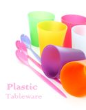 Colorful plastic tableware on white Stock Image