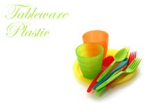 Colorful plastic tableware on white Stock Photos