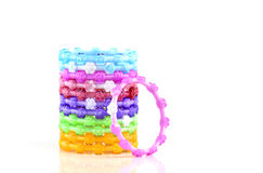 Colorful plastic toy bangle on white background Royalty Free Stock Photo