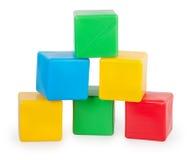 Colorful plastic toy blocks. Isolated on white background Royalty Free Stock Photo