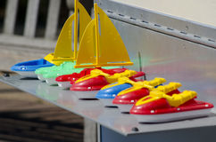 Colorful plastic toy boats Stock Photos
