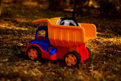 Colorful plastic toy dumpster truck outdoors Stock Photos