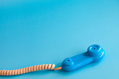 Colorful plastic toy mobile phone on a blue background Stock Photos