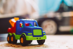 Colorful plastic toy truck on floor Royalty Free Stock Image