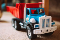 Colorful plastic toy truck on floor Stock Photos