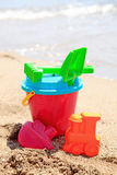 Colorful plastic toys at the beach Royalty Free Stock Photography