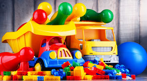 Colorful plastic toys in children's room Stock Photo