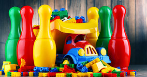 Colorful plastic toys in childrens room Stock Photo