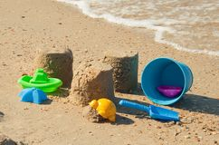 Colorful plastic toys on the sandy beach Stock Photography