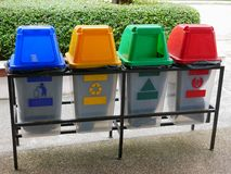 Colorful plastic trash bins / cans for waste separation. Colorful plastic trash bins / cans in four different colors for waste separation Stock Photo