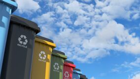 Colorful plastic trash cans with a logo recycling