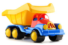 Colorful plastic truck toy on white Stock Images