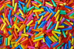 Colorful plastic tubes. Background from many plastic tubules Stock Image