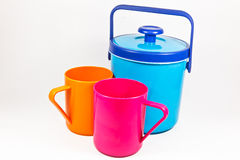 Colorful plastic water canteen and cups Stock Photo