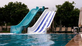 Colorful plastic water-slides in hotel. Working colorful plastic water-slides in hotel stock video