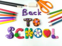 Colorful plasticine clay, text dough and stationery, white background Royalty Free Stock Photos