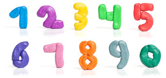Colorful plasticine digits. Isolated on a white background stock photo
