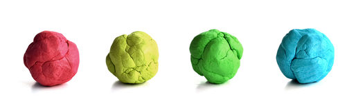 Colorful plasticine. Four colourful plasticine spheres of red, yellow, green and blue Royalty Free Stock Photo